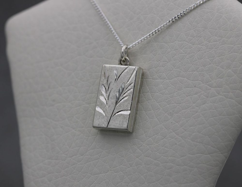 Small vintage sterling silver locket with floral / foliage engraving