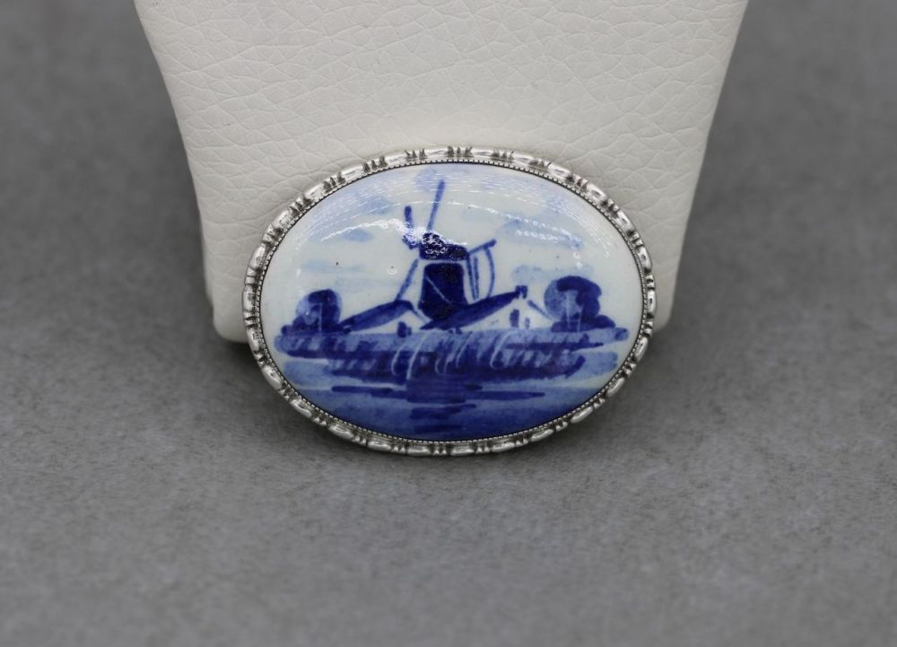 Sterling silver brooch with a ceramic blue & white windmill scene