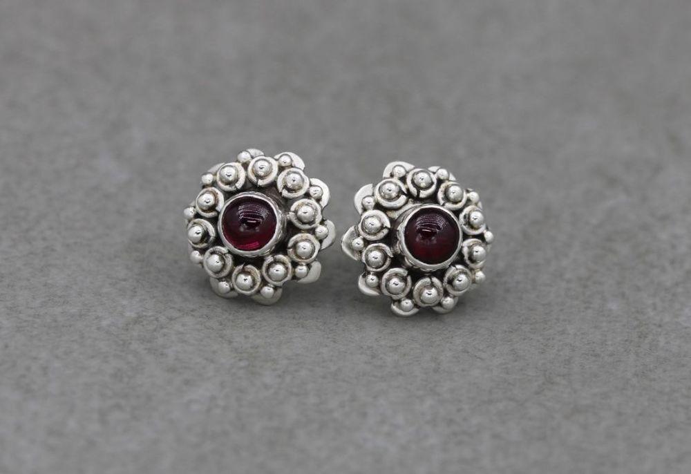 Fancy Bali sterling silver & garnet stud earrings