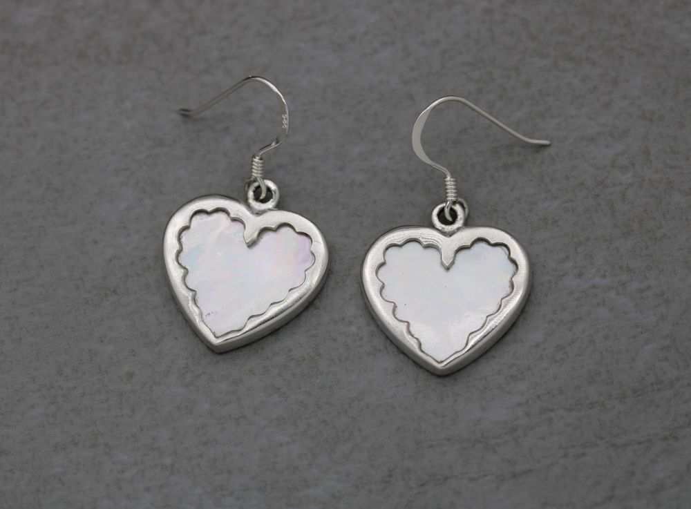 Sterling silver framed mother of pearl heart earrings