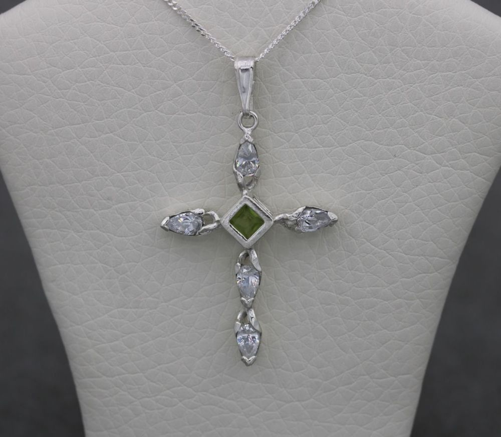 Sterling silver necklace with a green & clear stone cross