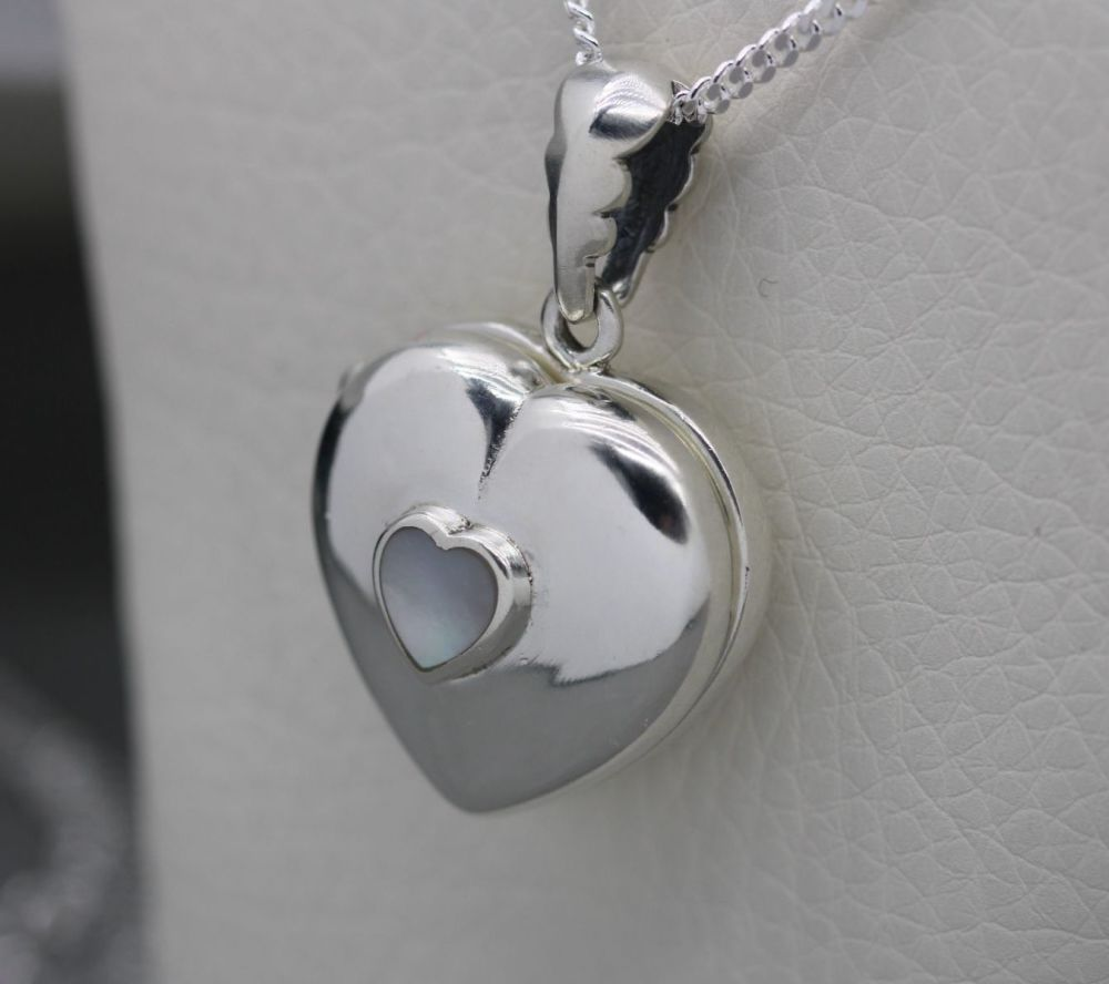 Sterling silver heart locket set with mother of pearl