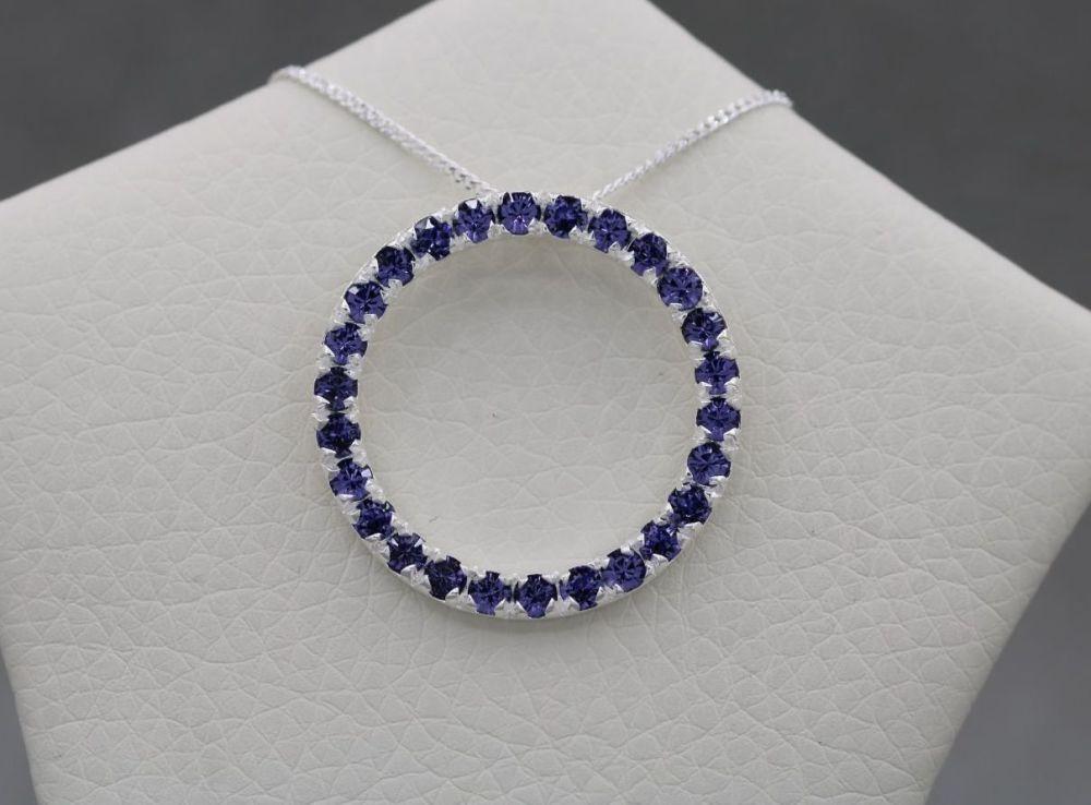 Sterling silver & tanzanite colour stone circle necklace