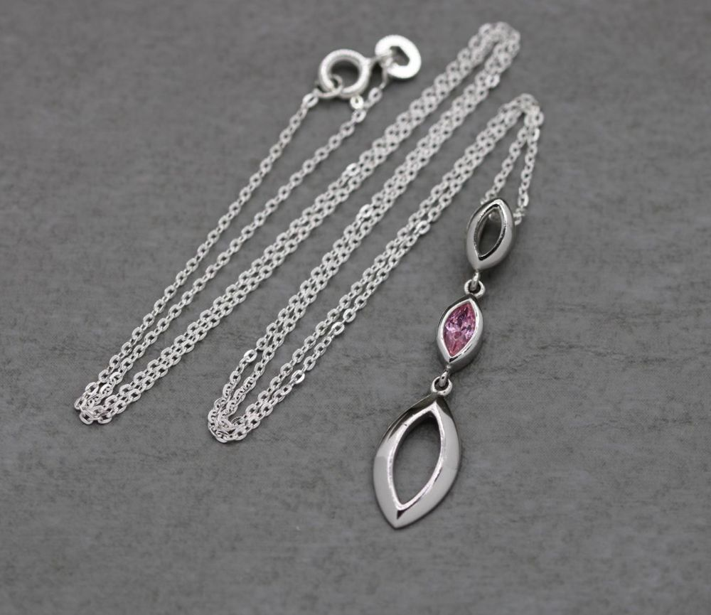 Sterling silver necklace with a pink marquise stone