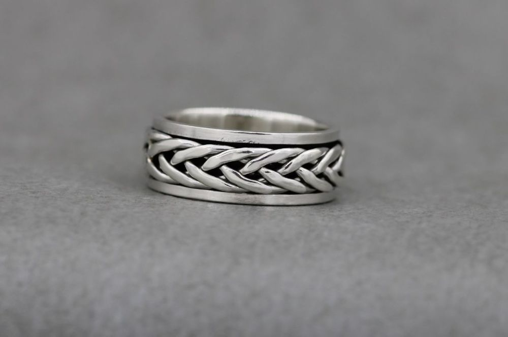 Sterling silver spinner ring with a woven band