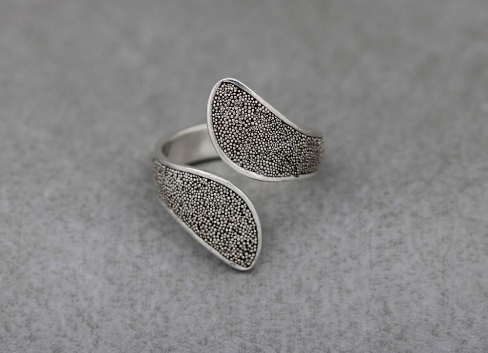 Wide textured sterling silver bypass ring