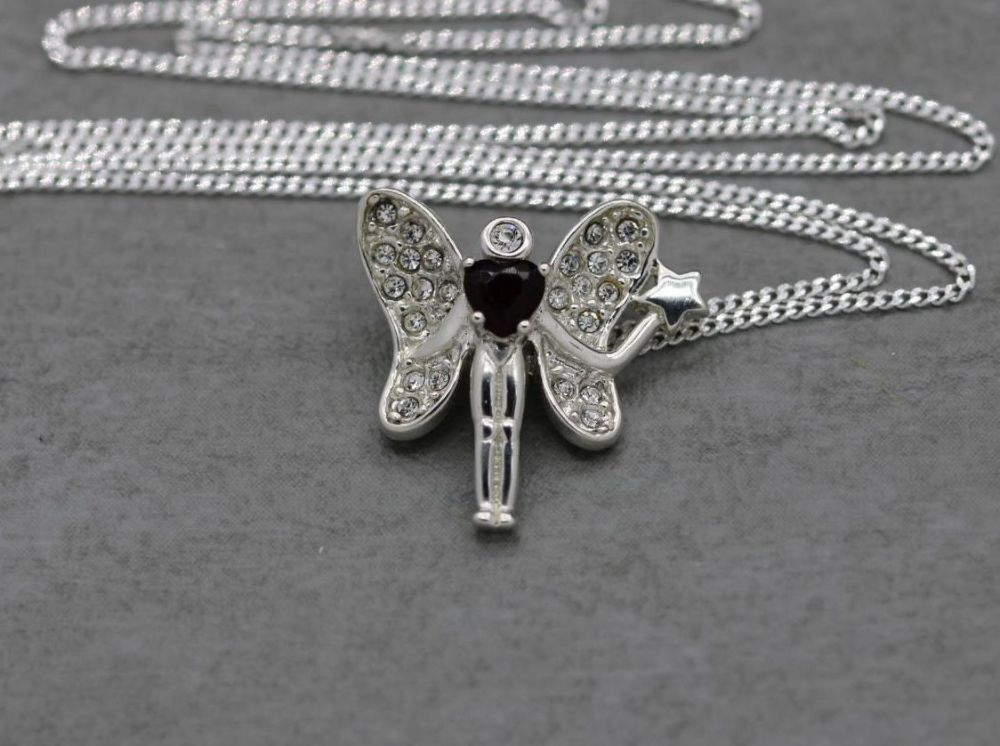 Sterling silver necklace with a clear stone fairy holding a deep dark red g