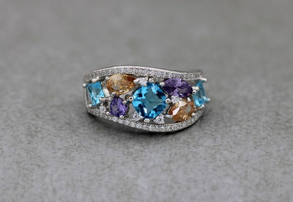 Graduated sterling silver ring with multi-colour stones