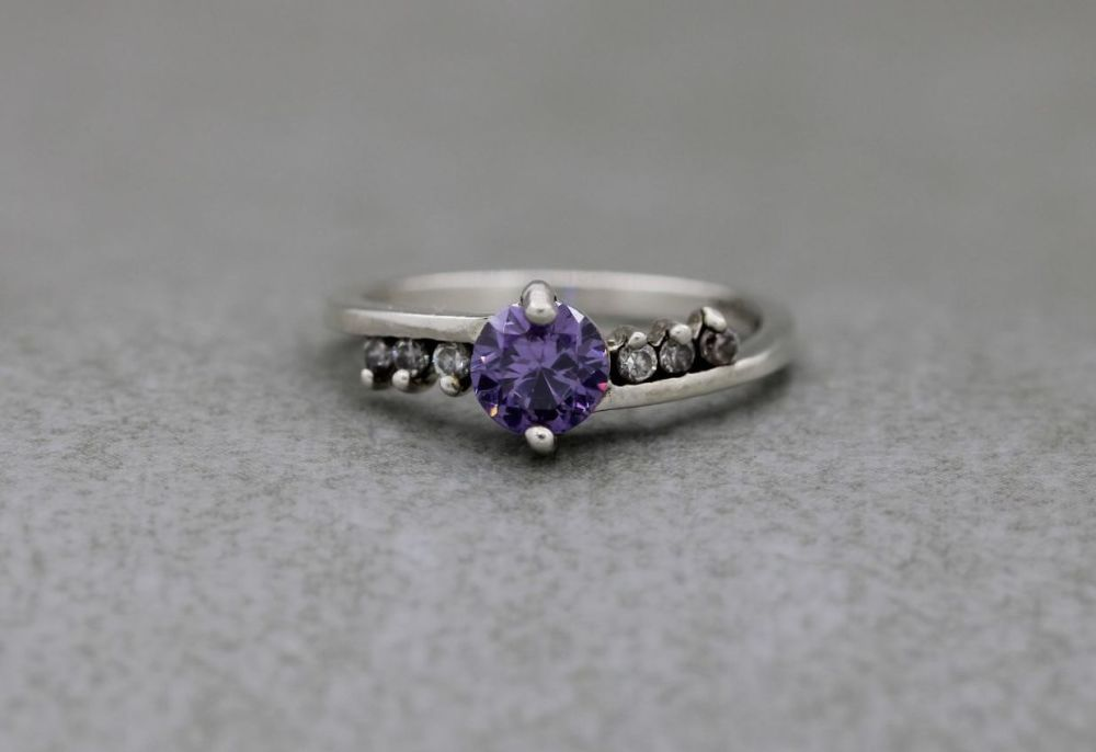 Sterling silver ring with purple & clear stones
