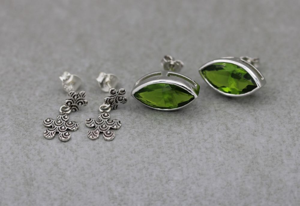2 x pairs of sterling silver earrings; green marquise studs & short textured drops