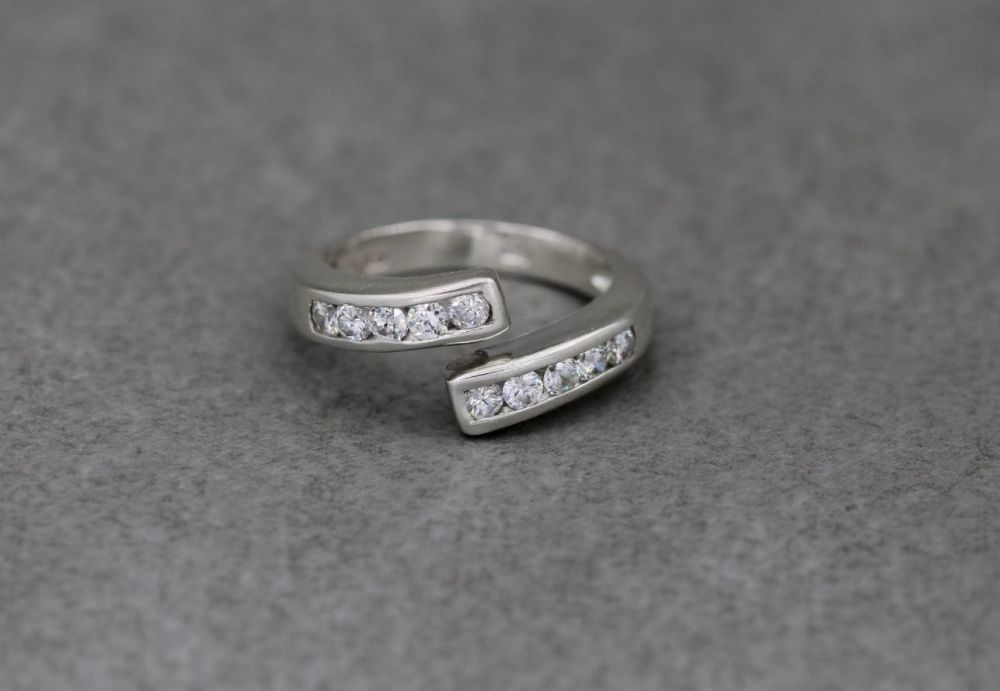 Sterling silver & clear stone bypass ring