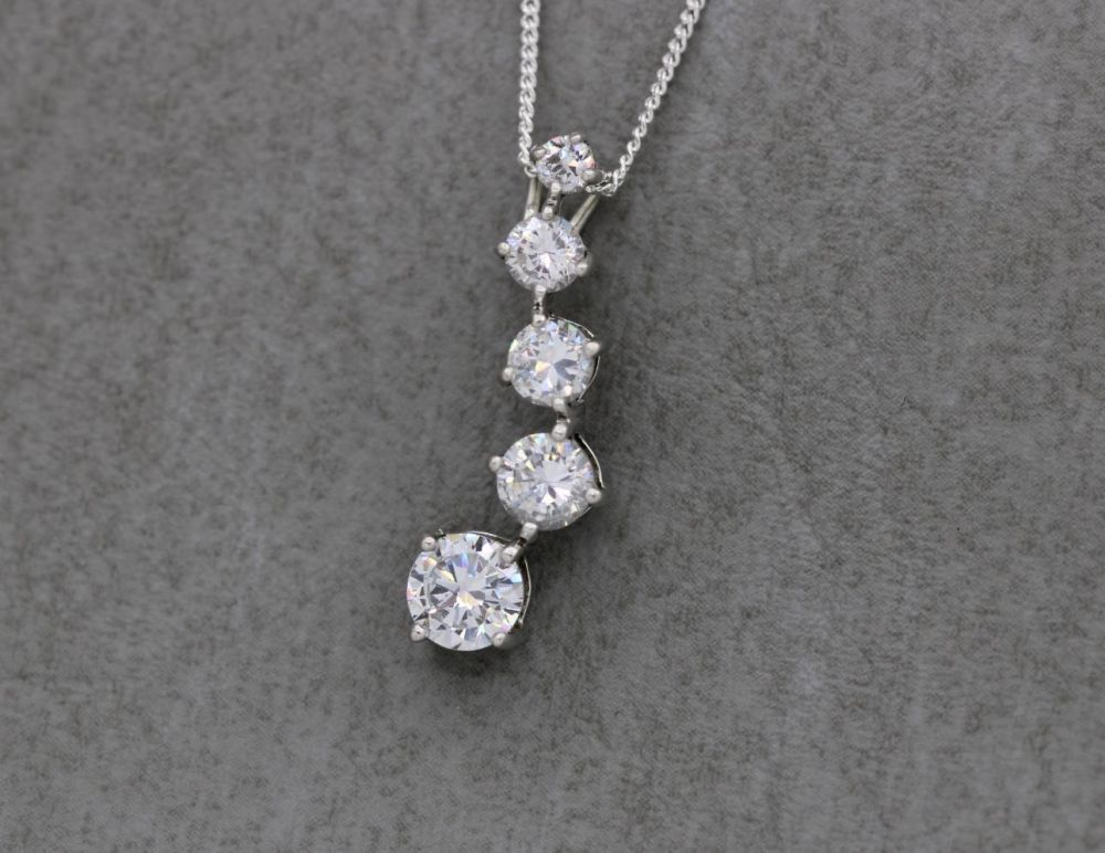 Sterling silver necklace with graduated clear stones
