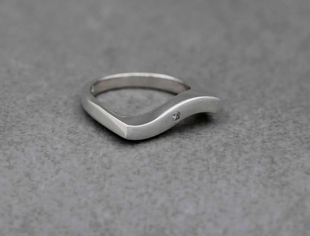 Unusual sterling silver wave ring with a single stone