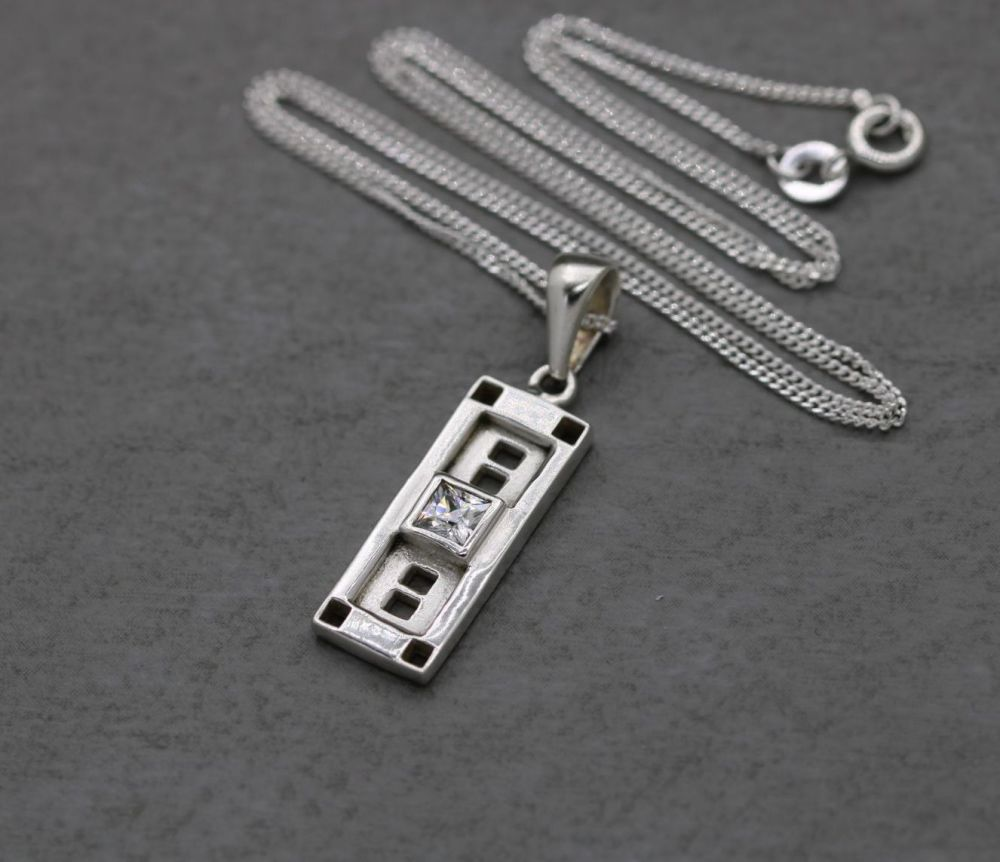 Sterling silver shadow box necklace with a clear square stone