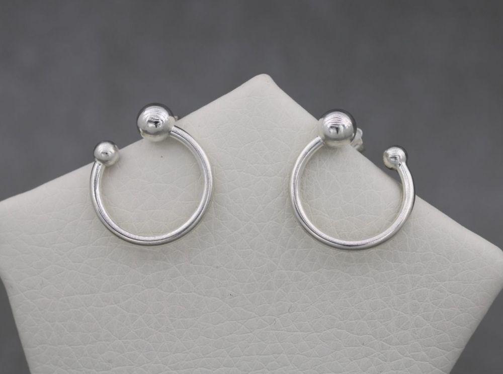 Sterling silver sideways hoop earrings
