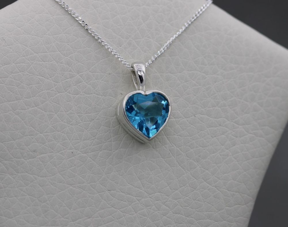 Sterling silver necklace with a blue faceted heart