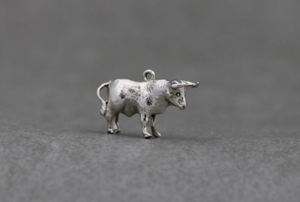 Vintage solid silver bull charm