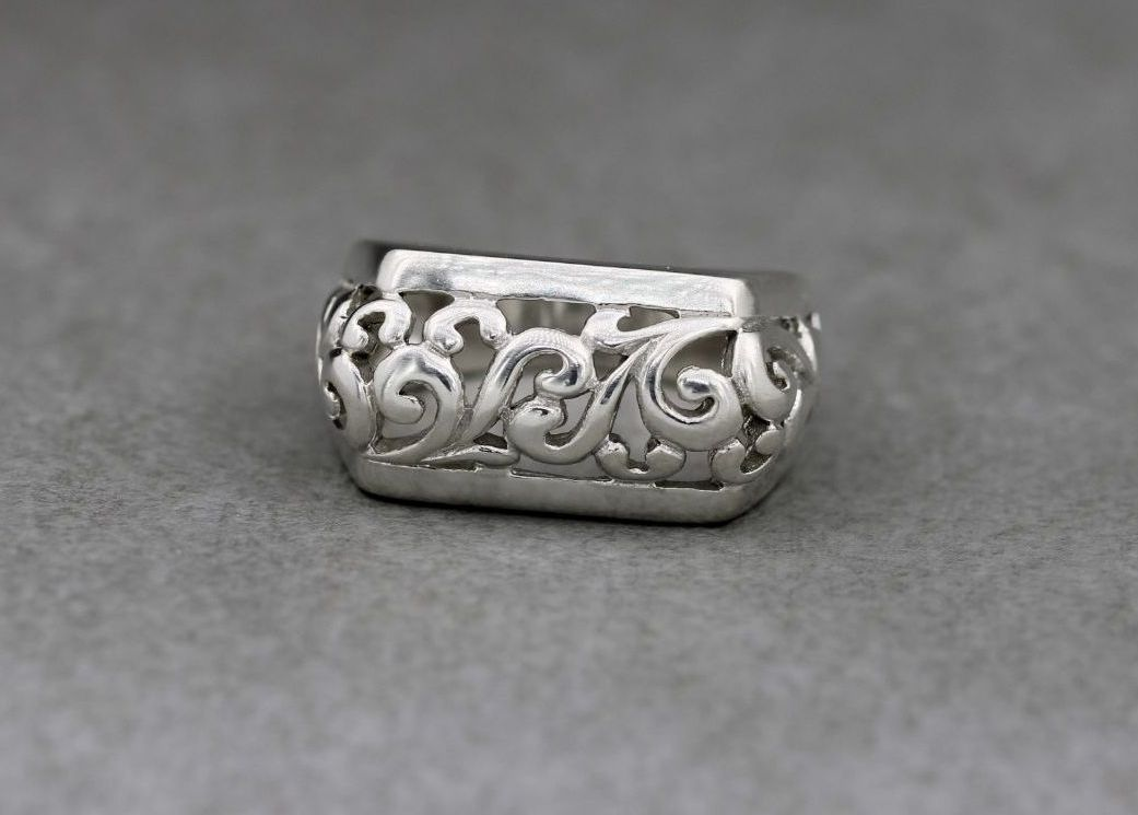 Fancy bold sterling silver ring with a scroll design