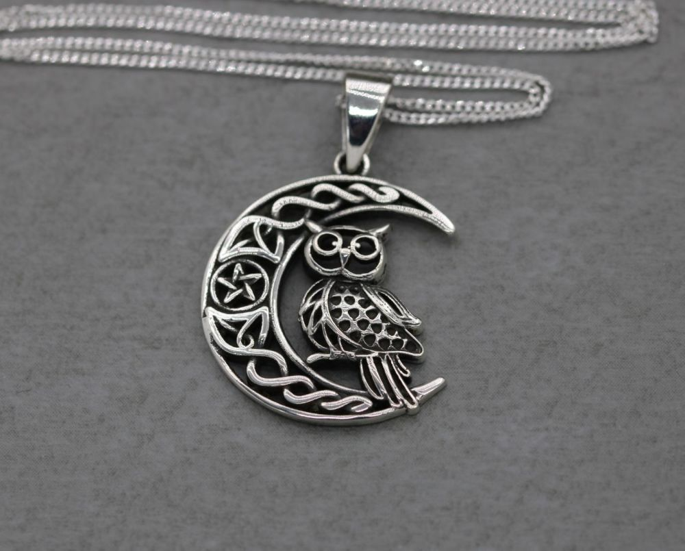 Sterling silver owl in a crescent moon necklace