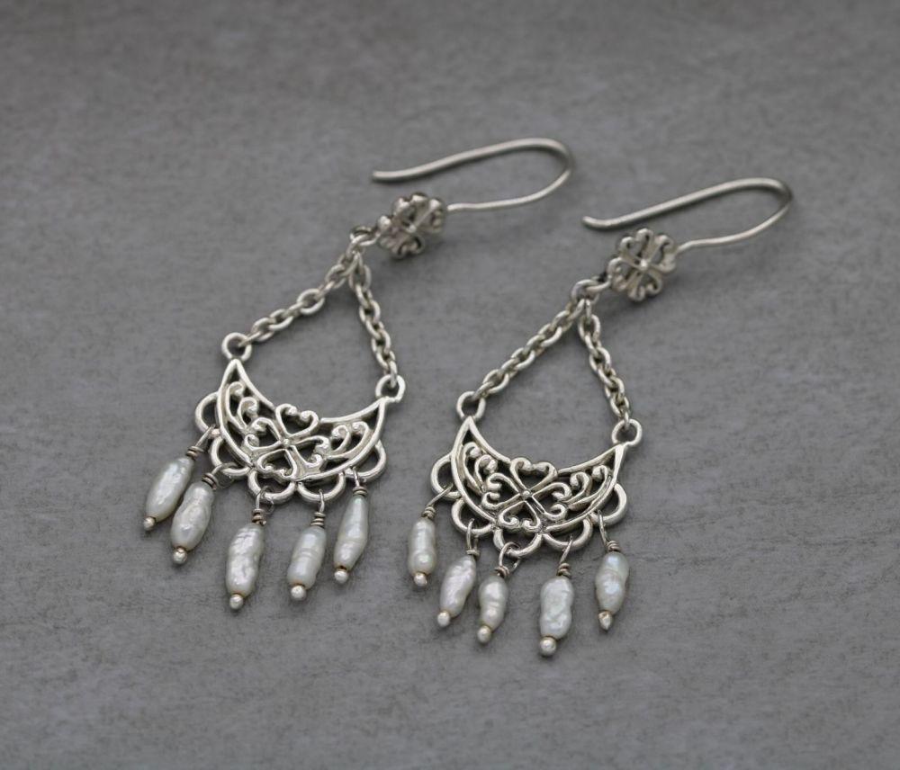 Fancy sterling silver earrings with a freshwater pearl fringe