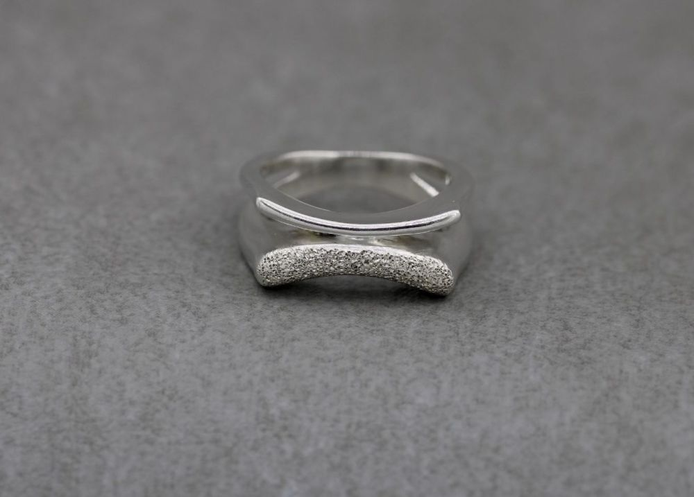 Unusual sterling silver ring with glitter texture
