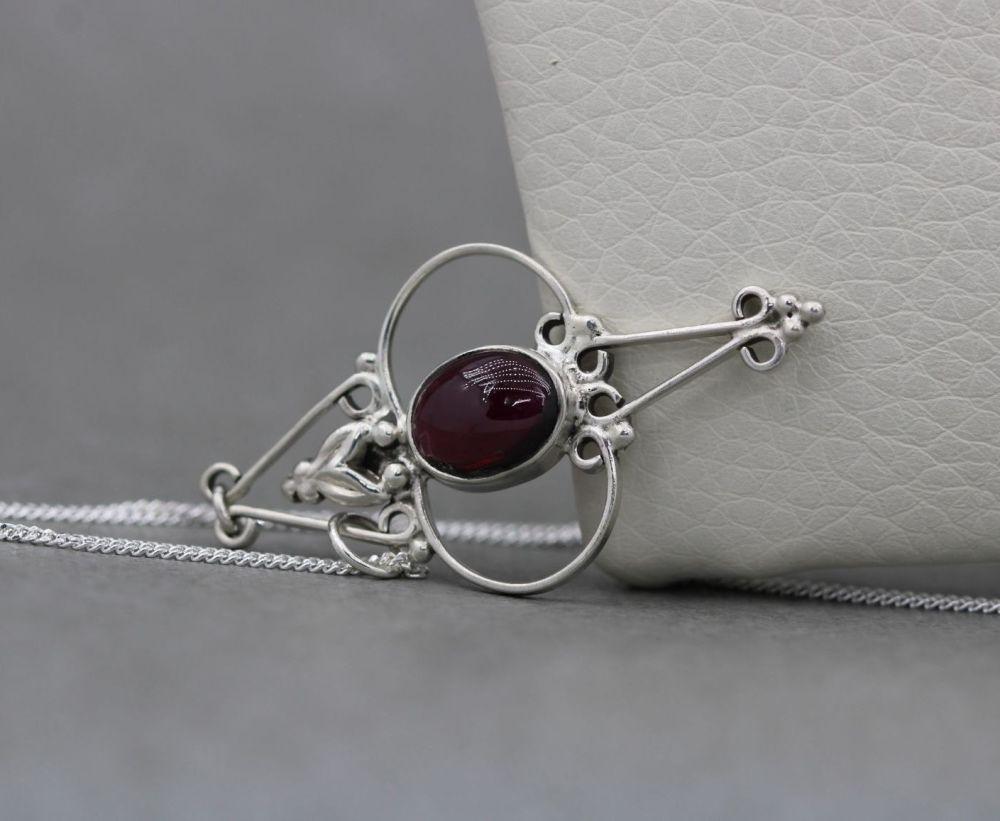 Fancy sterling silver & garnet necklace