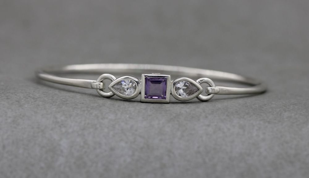 Sterling silver bangle with a square amethyst & clear pear cut stones