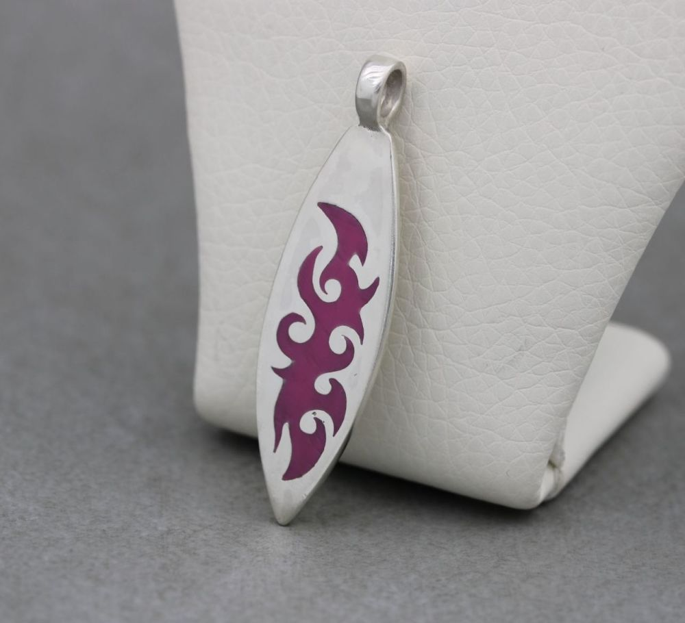 Sterling silver & pink enamel pendant; surfboard shape with tribal design