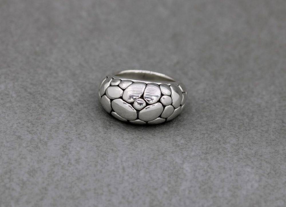 Domed sterling silver ring with an oxidised pebble design