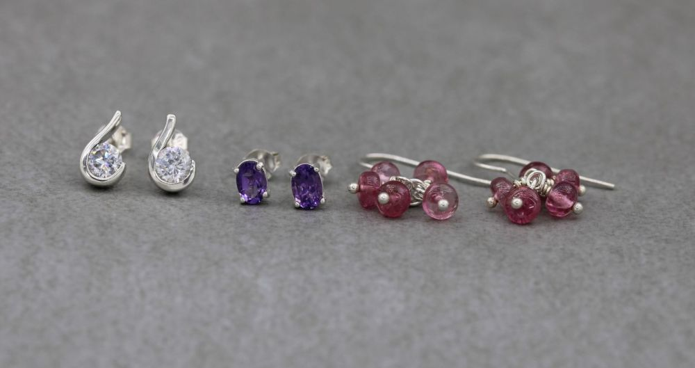 3 x pairs of sterling silver earrings; pink bead clusters, amethyst & clear stone studs