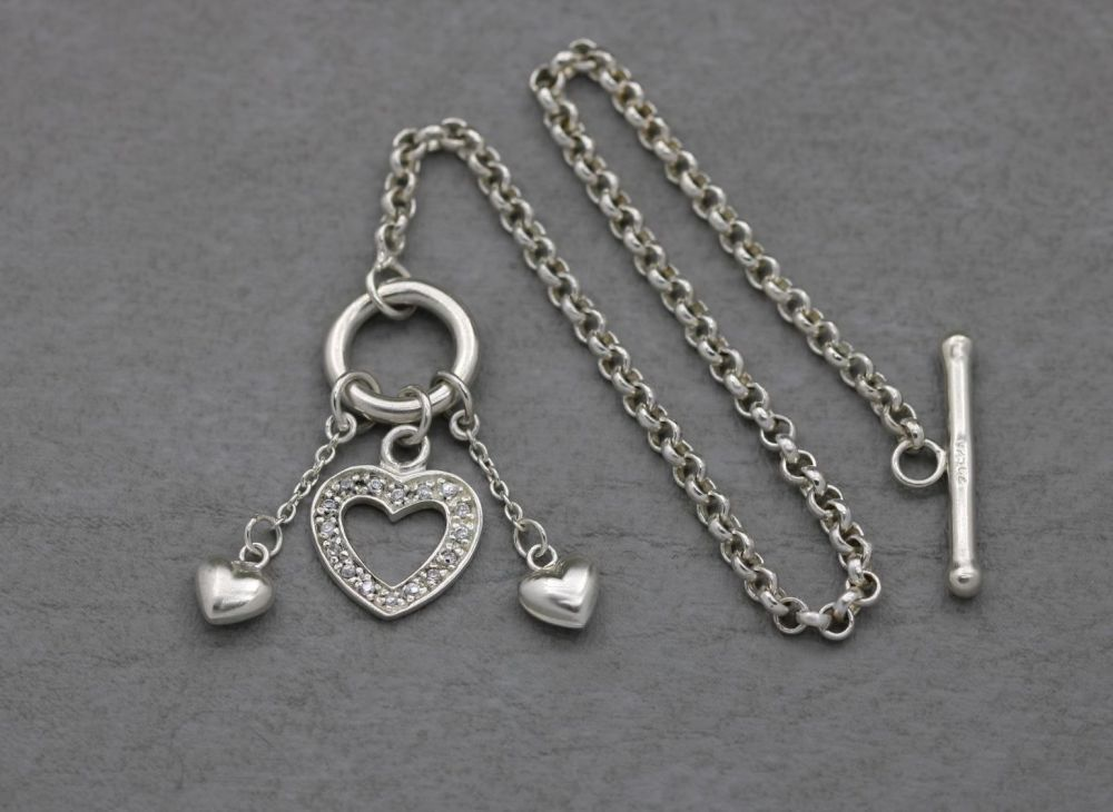 Sterling silver toggle bracelet with a trio of hearts