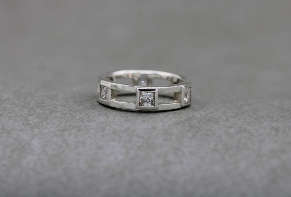 Sterling silver ring with evenly spaced clear square stones