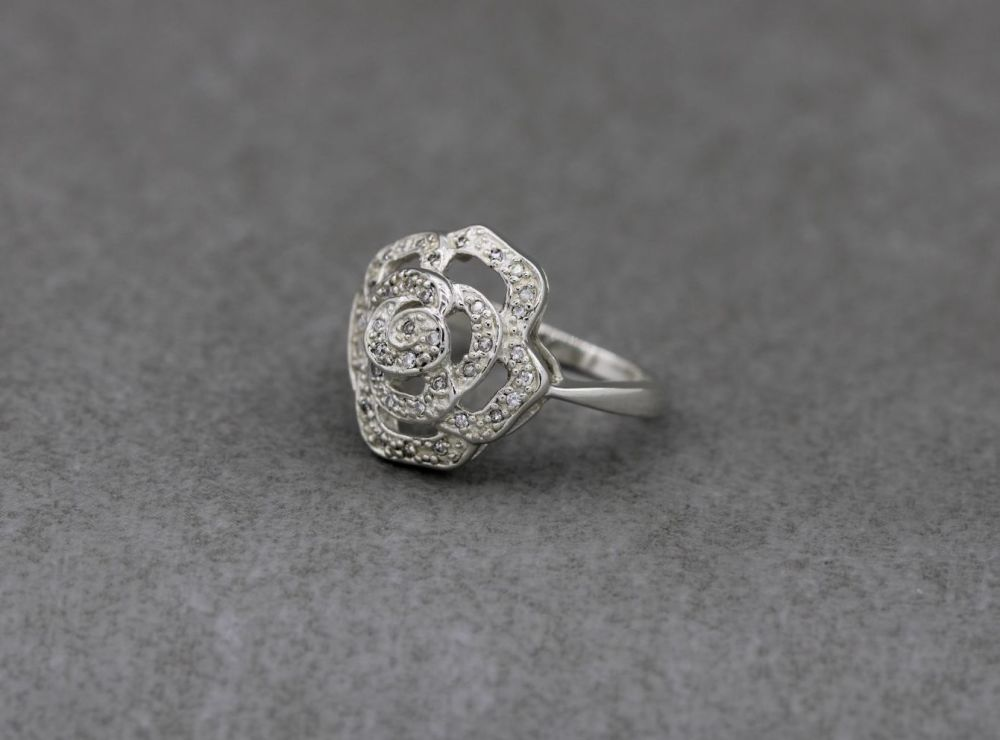 Sterling silver flower ring with clear stone detailed petals