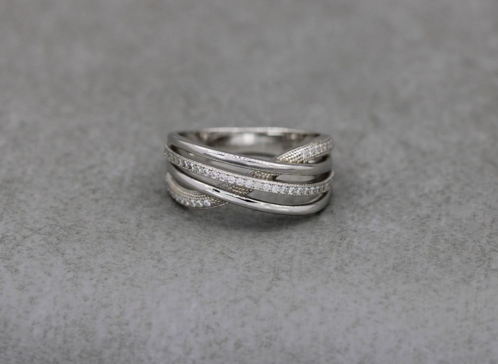 Elegant sterling silver multi-band effect ring with tiny clear stones (V)