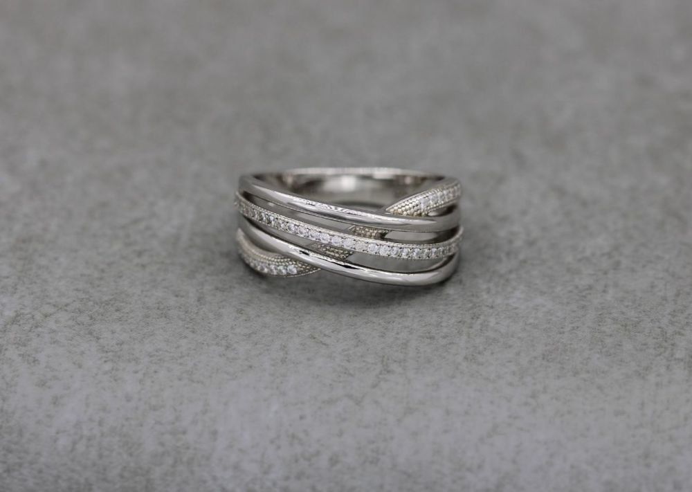 Elegant sterling silver multi-band effect ring with tiny clear stones (J)
