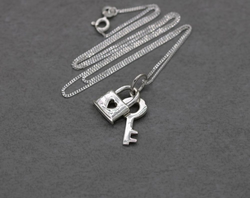 Sterling silver necklace with a lock & key pendant