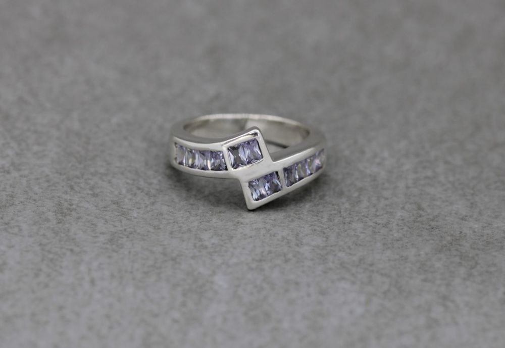Sterling silver bypass ring with pale lavender baguette stones