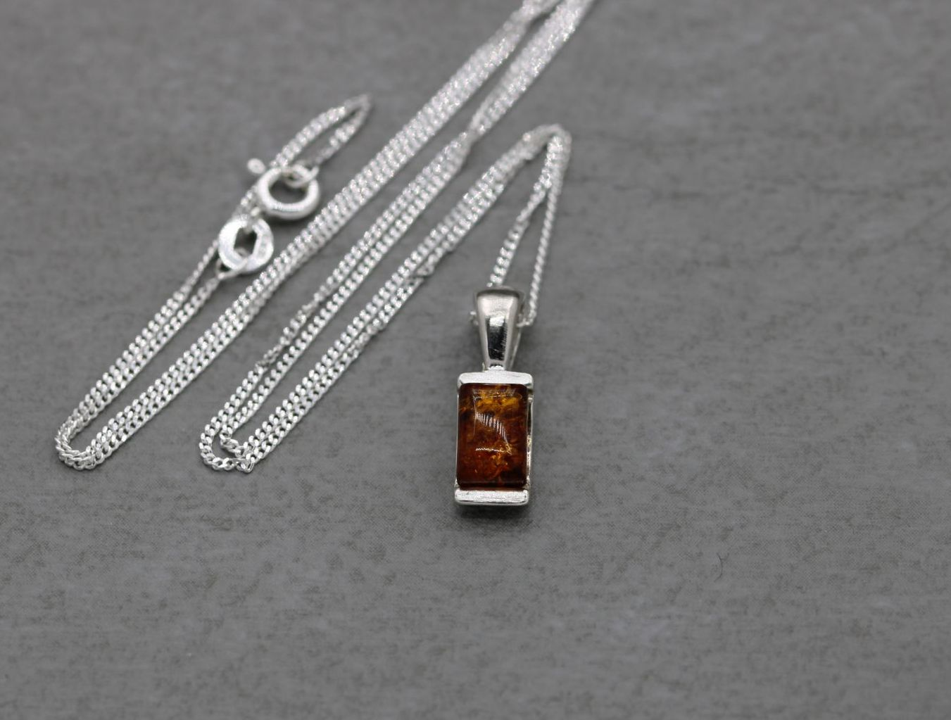 ST7000 Necklace small amber rectange cab in arc setting  (4)