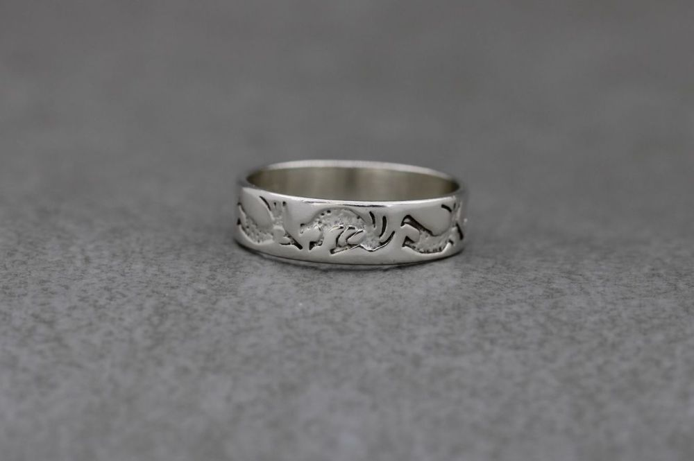 South western sterling silver ring; Kokopelli stamped band