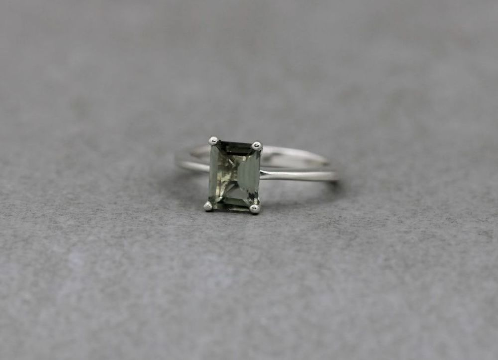 Sterling silver solitaire ring with a rectangular pale forest green stone