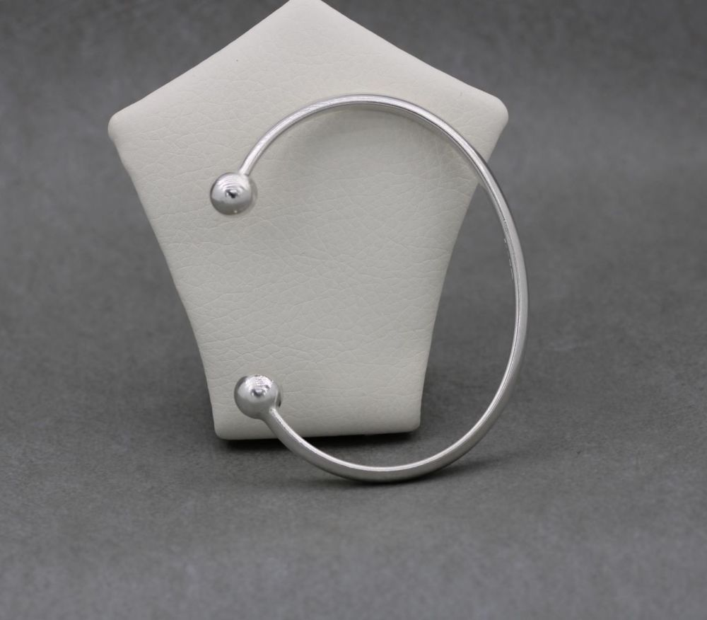 Classic solid sterling silver ball-tipped torque bracelet