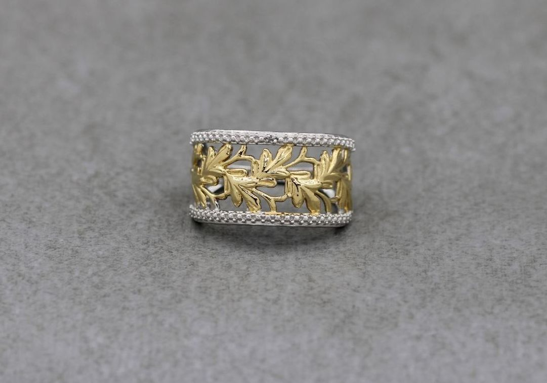 Fancy sterling silver ring with golden leaf detail