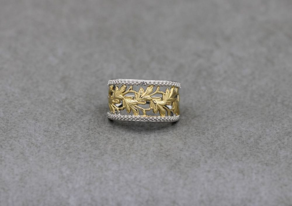 Fancy sterling silver ring with golden leaf detail (M 1/2)