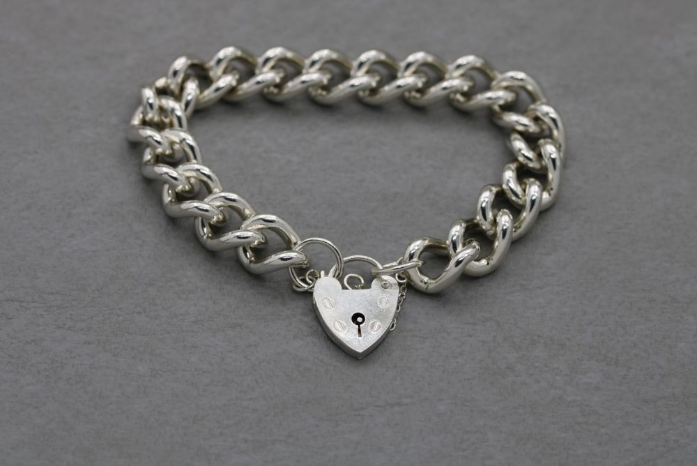 Heavy vintage sterling silver charm bracelet with padlock clasp & safety ch