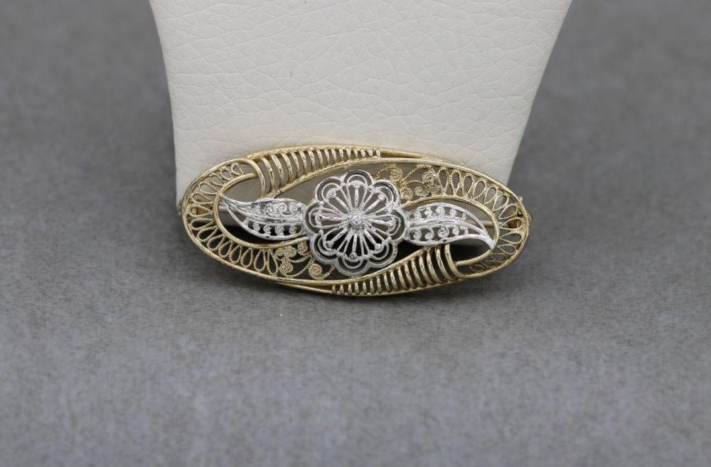 Vintage sterling silver floral filigree brooch with gilt detail