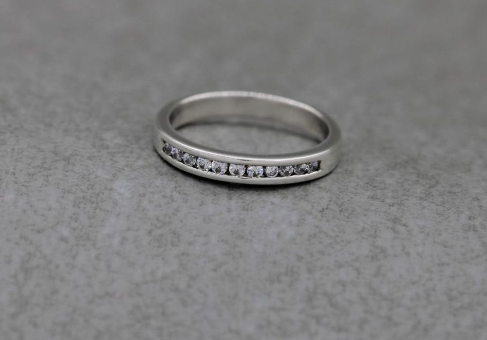 Slim sterling silver ring with channel set clear stones