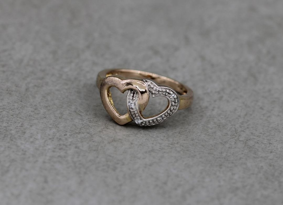 Gilt sterling silver double heart ring with clear stone detail