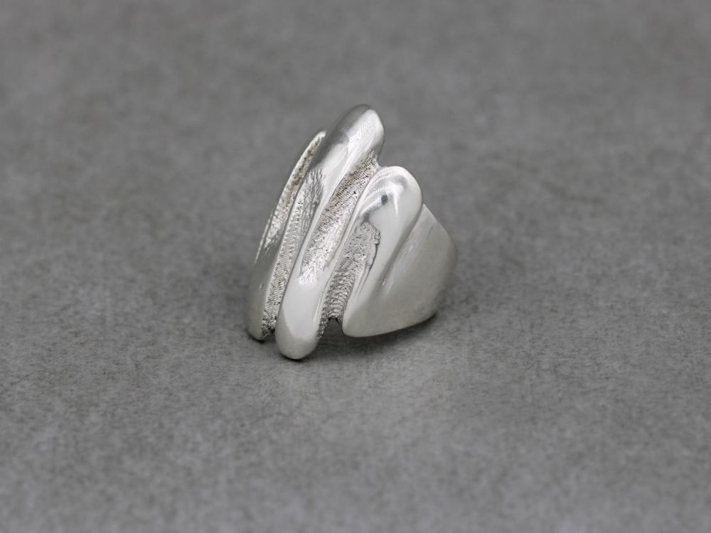 Handmade sterling silver ring with deep waves & texture