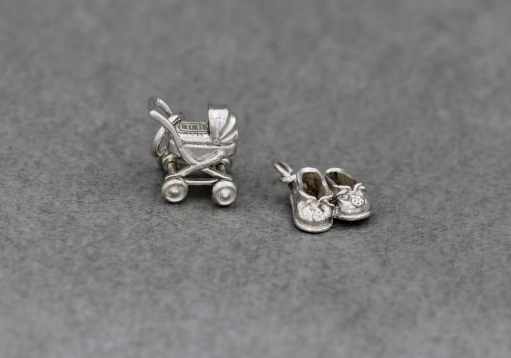 2 x vintage silver charms; pram with moving wheels & baby booties