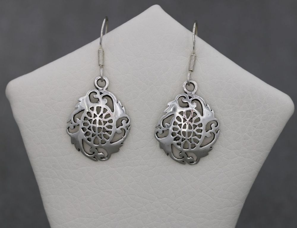 Sterling silver earrings with a cut-out design
